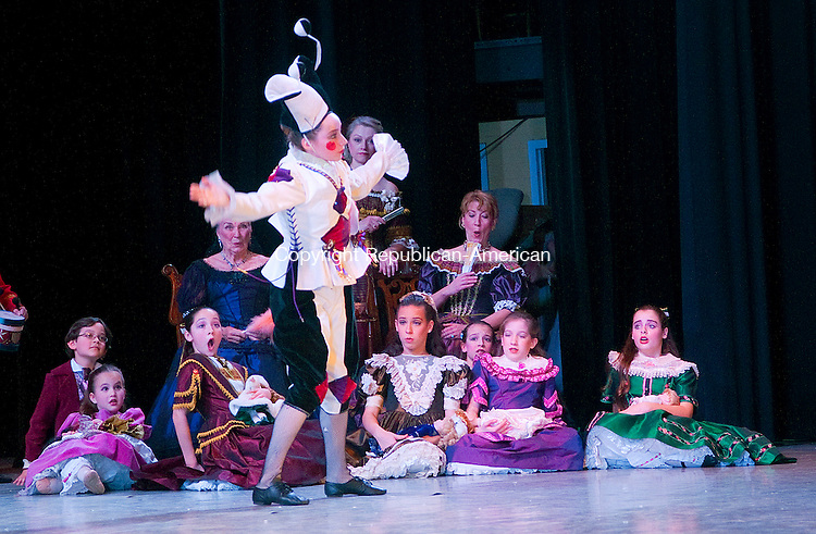 SOUTHBURY, CT-122213JS02-Dancers look on as the Harlequin, played by Rebecca Reimold, dances during the Main Street Ballet's 25th anniversary production of the Nutcracker Sunday at Pomperaug High School in Southbury. <br /> Jim Shannon Republican-American