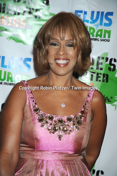 Gayle King in  Carmen Marc Valvo pink dress attending The Rosie's Theatre Kids Gala on September 19, 2011 at The New York Marriott Marquis Hotel in New York City.
