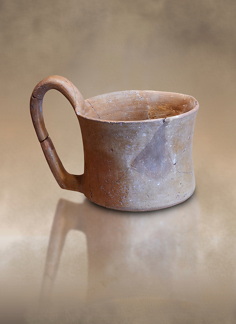 Hittite terra cotta big handled tankard mug. Hittite Empire, Alaca Hoyuk, 1450 - 1200 BC. Alaca Hoyuk. Çorum Archaeological Museum, Corum, Turkey. Against a warm art bacground.