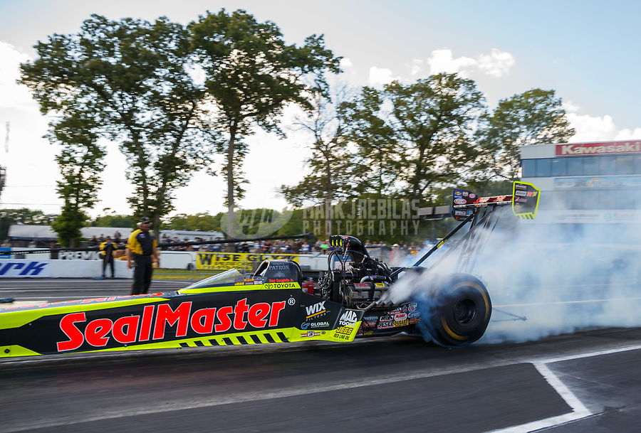 Jun 9, 2017; Englishtown , NJ, USA; NHRA top fuel driver Troy Coughlin Jr during qualifying for the Summernationals at Old Bridge Township Raceway Park. Mandatory Credit: Mark J. Rebilas-USA TODAY Sports