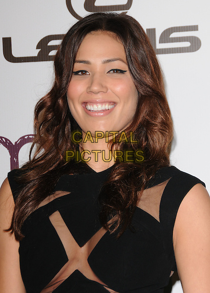 MICHAELA CONLIN .at The 2010 Environmental Media Association Awards held at WB Studios in Burbank, California, USA, .October 16th 2010..emas ema portrait headshot smiling sheer see thru through black .CAP/RKE/DVS.©DVS/RockinExposures/Capital Pictures.