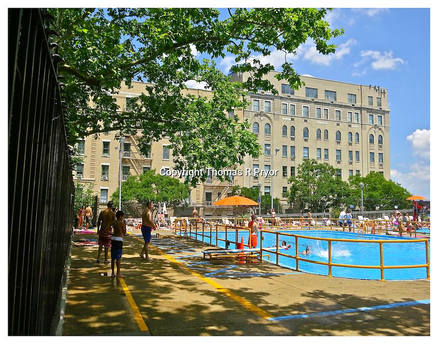 NEW YORK, NY - JULY 5: People swimming at John Jay Park swimming pool in Yorkville, New York on July 5, 2013. Photo Credit: Thomas R Pryor
