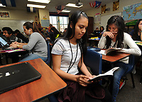 NWA Democrat-Gazette/ANDY SHUPE<br /> Katherine Ascencio (center), 17, and Lisset Martinez, 16, both sophomores at Har-Ber High School, read Thursday, April 13, 2017, in the language academy meant for English language learners at the school in Springdale. A new law, Act 991, changes testing and performance requirements for English language learners in the state's academic accountability system.