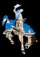 The State Capital Building of Cheyenne, Wyoming is seen through the cutout of a cowboy riding a horse from a fence next the the building, Thursday, June 2, 2011.  ..Photo by Matt Nager
