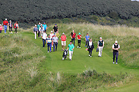 Dermot McElroy (IRL) and supporters walk down the 14th during the Afternoon Singles between Ireland and Wales at the Home Internationals at Royal Portrush Golf Club on Thursday 13th August 2015.<br /> Picture:  Thos Caffrey / www.golffile.ie