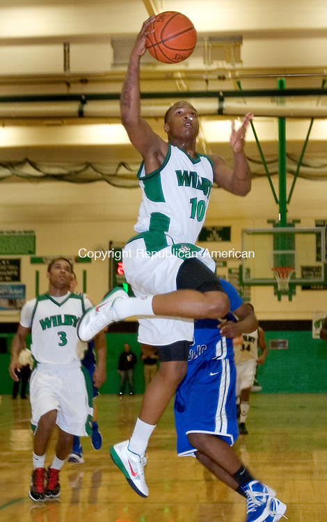 WATERBURY, CT. 07 March 2012-030712SV04-#10  Marcus Robinson of Wilby puts up a basket against East Catholic during the second round of the CIAC Class L basketball tournament at Wilby High in Waterbury Wednesday..Steven Valenti Republican-American