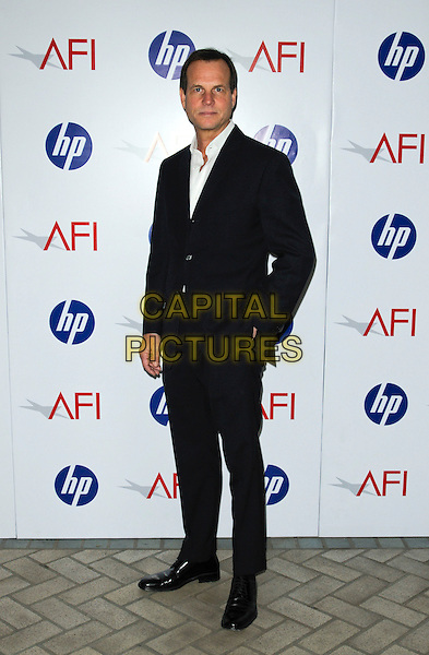 BILL PAXTON.At the 10th Annual AFI Awards at the Four Seasons Hotel in Los Angeles, California, USA, January 15th, 2010..arrivals Full length black suit white shirt  hand in pocket .CAP/ROT.©Lee Roth/Capital Pictures.