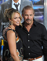 Kevin Costner &amp; wife Christine Baumgartner at the Los Angeles premiere of his movie &quot;Draft Day&quot; at the Regency Village Theatre, Westwood.<br /> April 7, 2014  Los Angeles, CA<br /> Picture: Paul Smith / Featureflash