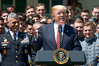 United States President Donald J. Trump makes remarks as he presents the Commander-in-Chief's Trophy to the U.S. Military Academy football team in the Rose Garden of the White House in Washington, DC on Tuesday, May 1, 2018.  The Commander-in-Chief's trophy is presented to the winner of the annual Army-Navy football game which was played at Lincoln Financial Field in Philadelphia, Pennsylvania on December 9, 2017.  The Army Black Knights beat the Navy Midshipmen 14 - 13.  Looking on from left is Lieutenant General Robert Caslen, US Army, Superintendent of the US Military Academy.<br /> Credit: Ron Sachs / CNP /MediaPunch