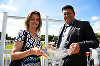 Connections of Secret Agent receive their trophy for winningThe Sharp's Doom Bar Handicap, during Afternoon Racing at Salisbury Racecourse on 13th June 2017