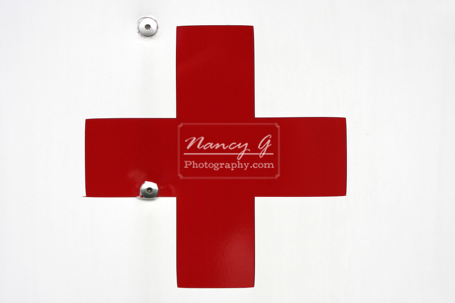 The Red Cross Symbol On The Side Of An Ambulance Vehicle Means
