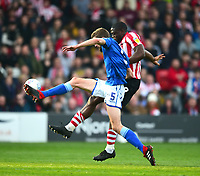 Lincoln City's John Akinde battles with Macclesfield Town's Fiacre Kelleher<br /> <br /> Photographer Andrew Vaughan/CameraSport<br /> <br /> The EFL Sky Bet League Two - Lincoln City v Macclesfield Town - Saturday 30th March 2019 - Sincil Bank - Lincoln<br /> <br /> World Copyright © 2019 CameraSport. All rights reserved. 43 Linden Ave. Countesthorpe. Leicester. England. LE8 5PG - Tel: +44 (0) 116 277 4147 - admin@camerasport.com - www.camerasport.com