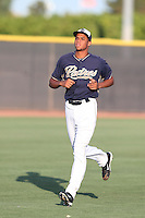 Jaimito Lebron #37 of the AZL Padres runs in the outfield before pitching against the AZL Diamondbacks at the Peoria Sports Complex on July 7, 2014 in Peoria, Arizona. AZL Padres defeated the AZL Diamondbacks, 9-4. (Larry Goren/Four Seam Images)