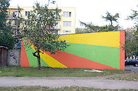 Sunshine wall painting on building. Balucki District Lodz Central Poland