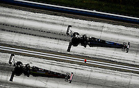 Apr. 28, 2012; Baytown, TX, USA: Aerial view of NHRA top fuel dragster driver Doug Kalitta (left) races alongside David Grubnic during qualifying for the Spring Nationals at Royal Purple Raceway. Mandatory Credit: Mark J. Rebilas-