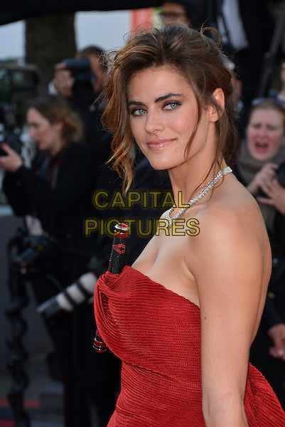 Allison Williams.'Blood Ties' premiere at the 66th  Cannes Film Festival, France..20th May 2013.half length red strapless dress folds twisted black stick baton folds side .CAP/PL.©Phil Loftus/Capital Pictures.