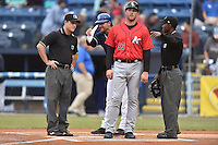 First base umpire Darrell Roberts, Asheville Tourists manager Warren Schaeffer (13), Kannapolis Intimidators manager Cole Armstrong (33) and home plate umpire Tom West before a game between the Tourists and the Intimidators at McCormick Field on May 19, 2016 in Asheville, North Carolina. The Intimidators defeated the Tourists 10-7. (Tony Farlow/Four Seam Images)