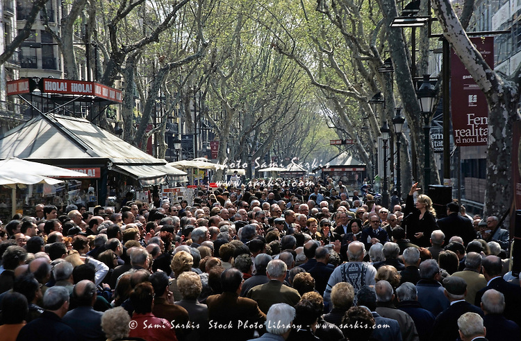 Crowds in La Rambla, an iconic and busy street in Barcelona, Spain.