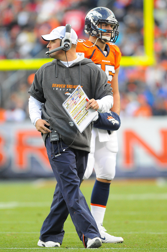 14 NOVEMBER 2010:  Broncos head coach Josh McDaniels  and Tim Tebow  during a regular season National Football League game between the Kansas City Chiefs and the Denver Broncos at Invesco Field at Mile High in Denver, Colorado. The Broncos beat the Chiefs 49-29.