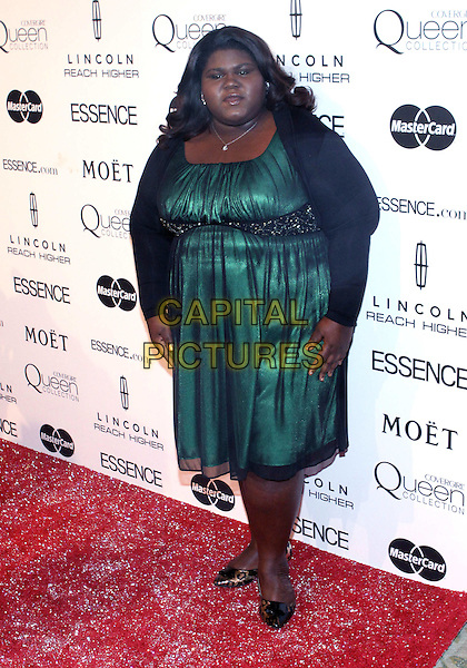"GABOUREY ""GABBY"" SIDIBE.The Third Annual ESSENCE Black Women In Hollywood Luncheon held at The Beverly Hills Hotel in Beverly Hills, California, USA. .March 4th, 2010 .full length black green dress  cardigan .CAP/ADM/TC.©T. Conrad/AdMedia/Capital Pictures."