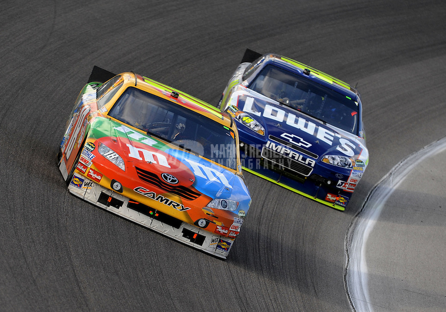 Nov. 21, 2010; Homestead, FL, USA; NASCAR Sprint Cup Series driver Kyle Busch leads Jimmie Johnson during the Ford 400 at Homestead Miami Speedway. Mandatory Credit: Mark J. Rebilas-