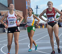 NWA Media/Michael Woods --05/29/2014-- w @NWAMICHAELW...Baylor runner and former Rogers High School track star Maggie Montoya (center) rests after crossing the finish line in the first heat of the women's 1500 meter preliminary Thursday afternoon at the 2014 NCAA Division 1 Track and Field West Preliminary track meet` at John McDonnell Field in Fayetteville.