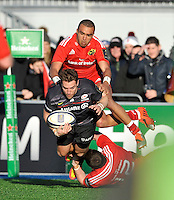 Hendon, England. Chris Wyles of Saracens tackled in action during the European Rugby Champions Cup match between Saracens and Munster at Allianz Park stadium on January 17, 2015 in Hendon, England.
