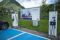 Switzerland. Canton Graubünden. Davos. On the parking place near Lake Davos, ABB EV charging solution for cars. Electric vehicle charging infrastructure. ABB lays the foundations for a future of smarter, reliable, and emission-free mobility, accessible by everyone, everywhere.  ABB offers a total ev charging solution from compact, high quality AC wallboxes, reliable DC fast charging stations with robust connectivity that meet the needs of the next generation of smarter mobility. ABB Ability connected chargers enable fast global service and pro-active maintenance. ABB has years of experience in creating, installing and maintaining charging infrastructure, including several nationwide charger networks. 11.07.2020 © 2020 Didier Ruef