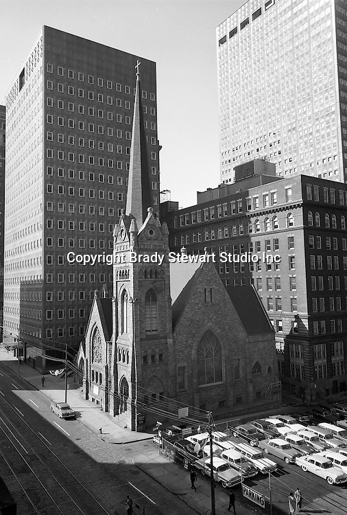 Pittsburgh PA:  The First English Evangelical Lutheran Church has served Pittsburgh since its founding in 1837. The First Lutheran Church is located in downtown Pittsburgh - 1956.  The Alcoa and  H.K. Porter buildings are in the background.