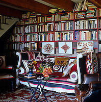 The huge collection of books is housed in floor-to-ceiling book shelves in the cosy library