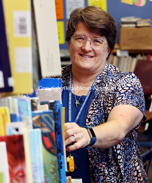 WATERBURY CT. 08 Augusr 2017-080817SV05-Katherin Sniffin, principal, gets ready for the first day of school at Children's Community School in Waterbury Tuesday.<br /> Steven Valenti Republican-American