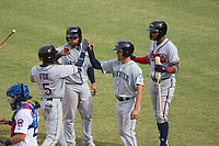 Peoria Javelinas teammates Mario Feliciano (6), Chris Mariscal (19), and Izzy Wilson (7) congratulate Lucius Fox (5), of the Tampa Bay Rays organization, as he crosses the plate in front of catcher P.J. Higgins (12) after he hit a home run during an Arizona Fall League game against the Mesa Solar Sox on October 11, 2018 at Sloan Park in Mesa, Arizona. The Solar Sox defeated the Javelinas 10-9. (Zachary Lucy/Four Seam Images)