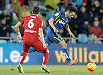 Getafe's Pablo Sarabia (r) and Atletico de Madrid's Koke Resurrecccion during La Liga match. February 14,2016. (ALTERPHOTOS/Acero)