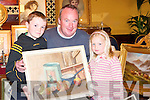 INTERESTED: James, David and Laura Sheahan (Listowel) interested in one of the many paintings on display at the Antiques Road Show in Listowel Arms Hotel on Sunday..