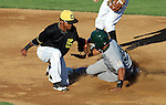 SIOUX FALLS, SD - JULY 2 Ty Forney #2 from the Sioux Falls Canaries puts the tag on Donald Blunt #31 from the Gary Southshore Railcats on an attempted steal in the second inning Wednesday night at the Sioux Falls Stadium. (Photo by Dave Eggen/Inertia)