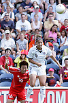 27 August 2006,  Natasha Kai (USA)(6) rises above Liu Yali (CHN)(16) to win a head ball.  The USA Women's National Team defeated China by a score of 4-1 in an international friendly match at Toyota Park, Bridgeview, Illinois.