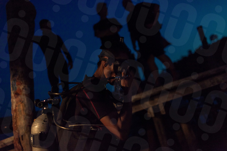 19 February, 2013 - Koh Rong (Sihanoukville). A diver jumps in the water for a night diving in the port of Koh Rong. © Thomas Cristofoletti / Ruom