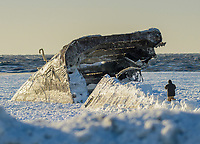 A man walks on the frozen Delaware Bay near the SS Atlantus sunken ship Friday, January 05, 2018 in Cape May Point, New Jersey. (Photo by William Thomas Cain/Cain Images)