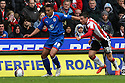 Jamaal Lascelles of Stevenage (on loan from Nottm Forest) escapes from Michael O'Halloran of Sheffield United. - Sheffield United v Stevenage - npower League 1 - Bramall Lane, Sheffield  - 28th April, 2012. © Kevin Coleman 2012
