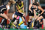 14 November 2015: Michigan's Shannon Scavelli (3) is defended by Wake Forest's Heather Wiley (right) and Veerle Bos (NED) (left). The Wake Forest University Demon Deacons played the University of Michigan Wolverines at Francis E. Henry Stadium in Chapel Hill, North Carolina in a 2015 NCAA Division I Field Hockey Tournament First Round match. Michigan won the game 2-1.