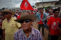 Supporters of Yingluck Shinawatra, sister of toppled premier Thaksin Shinawatra and the prime ministerial candidate for the country's biggest opposition Pheu Thai Party wear sunglasses as they gather for pre-election rally in Phu Khieo in the northeast of Thailand June 24, 2011. The mostly low-income red shirts broadly support ousted populist premier Thaksin Shinawatra in a five-year political conflict against the traditional Bangkok elite that includes top generals, royal advisers, middle-class bureaucrats, business leaders and old-money families who back the ruling Democrat Party. Thais will go to the polls on July 3 for a general election.   REUTERS/Damir Sagolj (THAILAND)