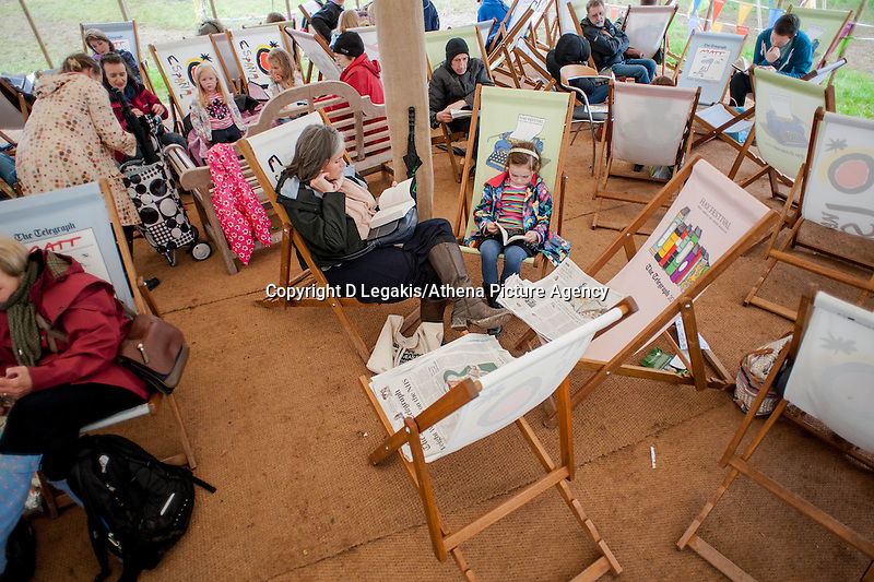 Thursday  29 May 2014, Hay on Wye, UK<br /> Pictured: People relax and shelter from the rain at the Hay festival <br /> Re: The Hay Festival, Hay on Wye, Powys, Wales UK.