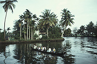 Villagers crossing the backwater by catamarans, Alleppey, Kerala, India.
