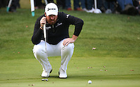 Shane Lowry (IRL) eyes the line on the 17th during the Final Round of the British Masters 2015 supported by SkySports played on the Marquess Course at Woburn Golf Club, Little Brickhill, Milton Keynes, England.  11/10/2015. Picture: Golffile | David Lloyd<br /> <br /> All photos usage must carry mandatory copyright credit (© Golffile | David Lloyd)