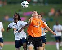 Mustapha Riga of the Bolton Wanderers and Jo Conner of the Charlotte Eagles contest a header.  The Charlotte Eagles currently in 3rd place in the USL second division played a friendly against the Bolton Wanderers from the English Premier League losing 3-0.