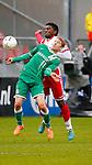 Nederland, Utrecht, 23 februari 2014<br /> Eredivisie<br /> Seizoen 2013-2014<br /> FC Utrecht-FC Groningen<br /> Michael de Leeuw (l.) van FC Groningen en Gevero Markiet van FC Utrecht strijden om de bal.