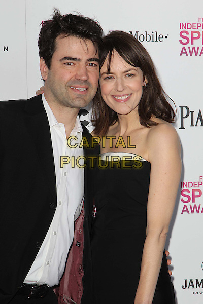 Ron Livingston, Rosemarie DeWitt.2013 Film Independent Spirit Awards - Arrivals  Held At Santa Monica Beach, Santa Monica, California, USA, .23rd February 2013..iny indys half length arm around husband wife couple black suit white strapless shirt silver catsuit .CAP/ADM/FS.©Faye Sadou/AdMedia/Capital Pictures.