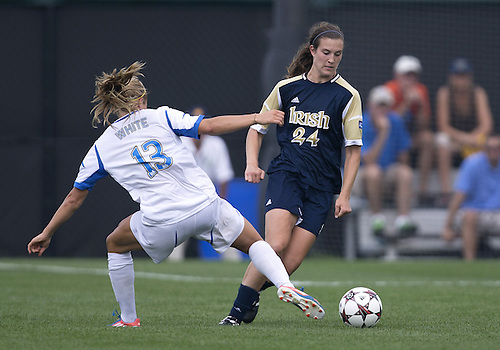 September 01, 2013:  Notre Dame defender Katie Naughton (24) advances the ball as UCLA forward Rosie White (13) defends during NCAA Soccer match between the Notre Dame Fighting Irish and the UCLA Bruins at Alumni Stadium in South Bend, Indiana.  UCLA defeated Notre Dame 1-0.