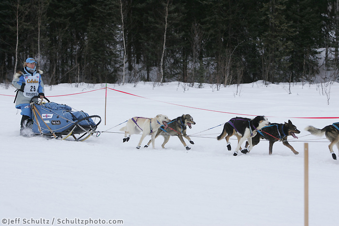 Dee Dee Jonrowe and team team on trail shortly after leaving Willow Restart .  2005 Iditarod Sled Dog Race