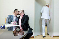 Yaroslav Yevtushenko embraces his boyfriend Dmitry Chunosov at St. Petersburg's registry office where, on 28 June 2013, five same sex couples attempted to officially submit applications to register their marriages. According to media reports all the submissions were rejected by the authorities. On 30 June 2013, Russian President Vladimir Putin signed into law an ambiguous bill banning the 'propaganda of nontraditional sexual relations to minors'. The law met with widespread condemnation from human rights and LGBT groups. /Felix Features (MANDATORY CREDIT   photo: Mads Nissen/Panos Pictures /Felix Features)